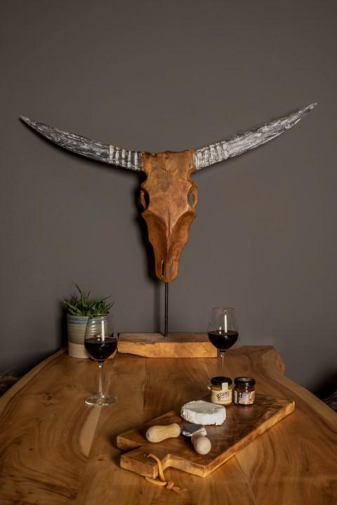 Buffelkop op voet - naturel wax - teak